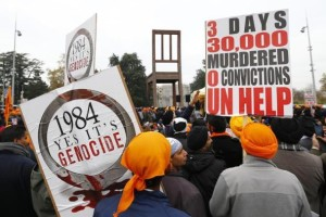 Sikh minority representatives stand in front of the European headquarters of the United Nations in Geneva November 1, 2013 after representatives of several NGOs urged the UN High Commissioner for Refugees (UNHCR) to recognize the 1984 killing of Sikhs as genocide. Credit: Reuters/Denis Balibouse