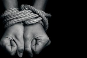 Modern slavery. Credit: ChameleonsEye/Shutterstock