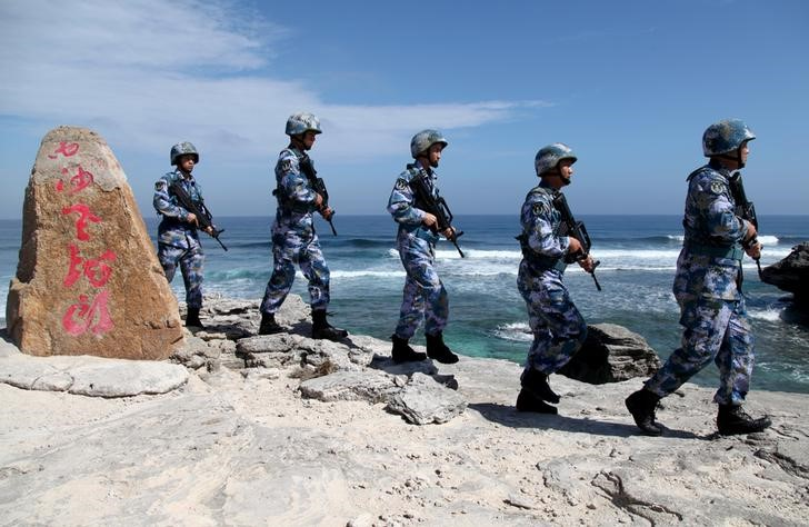 Soldiers of China's People's Liberation Army (PLA) Navy patrol at Woody Island, in the Paracel Archipelago, which is known in China as the Xisha Islands, January 29, 2016. Credit: Reuters/Stringer