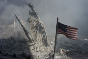 An American flag flies near the base of the destroyed World Trade Center in New York, in this file photo from September 11, 2001, taken after the collapse of the towers. Credit: Reuters/Peter Morgan-Files