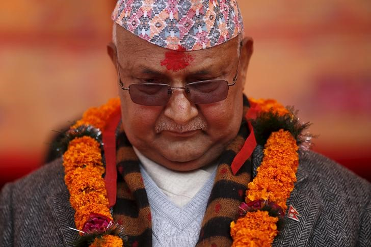 Nepal's Prime Minister Khadga Prasad Sharma Oli, also known as KP Oli, observes a minute of silence for earthquake victims during an event organised to mark the 18th National Earthquake Safety Day and the official launch of earthquake reconstruction efforts in Bungamati village, Nepal January 16, 2016. Credit: Reuters/Files