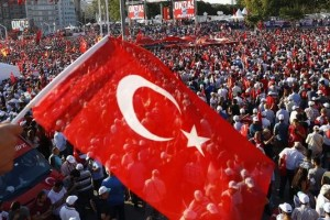 A man waves Turkey's national flag as he with supporters of various political parties gathers in Istanbul's Taksim Square during the Republic and Democracy Rally organised by main opposition Republican People's Party (CHP), Turkey, July 24, 2016. Osman Orsal, Reuters/Files