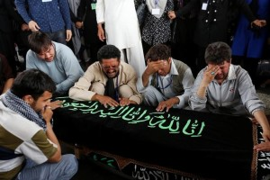 Men mourn over the coffin of a victim a day after a suicide attack in Kabul, Afghanistan July 24, 2016. Credits: REUTERS/Mohammad Ismail