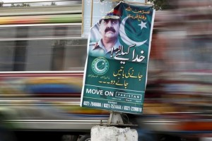A bus moves past a banner hanging on a light pole with the picture of Pakistan's Army Chief of Staff General Raheel Sharif along a road in Karachi, Pakistan February 25, 2016. Reuters/Files