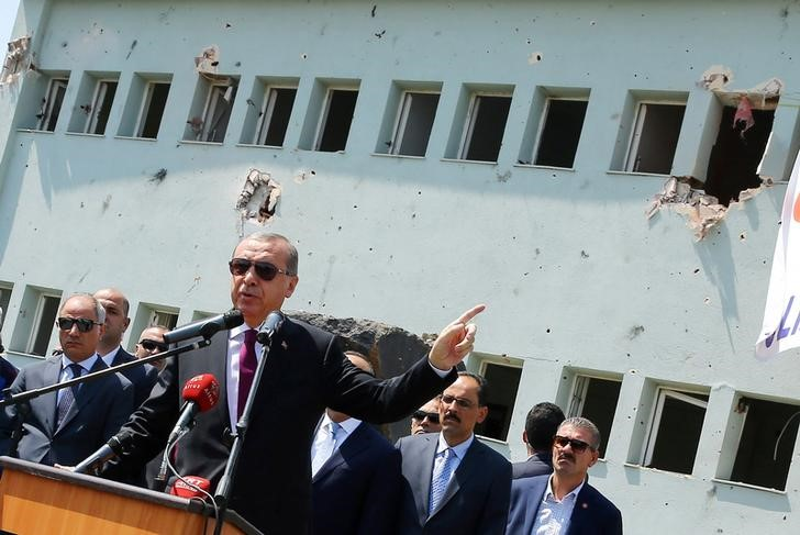 Is Turkey Turkey's President Tayyip Erdogan addresses the audience as he visits the Turkish police special forces base damaged by fighting during a coup attempt in Ankara, Turkey, July 29, 2016. Kayhan Ozer/Courtesy of Presidential Palace via Reuters/Files