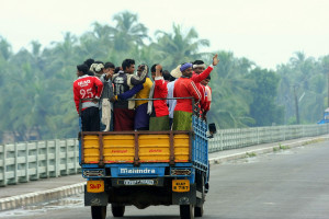 Workers in a truck in Kerala. Credit: Dhruvaraj S/Flickr (CC BY 2.0)