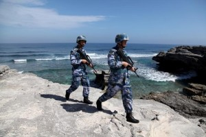 FILE PHOTO: Soldiers of China's People's Liberation Army (PLA) Navy patrol on Woody Island, in the Paracel Archipelago, which is known in China as Xisha Islands, January 29, 2016. REUTERS/Stringer/Files