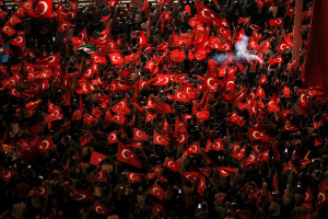 Supporters of Turkish President Tayyip Erdogan wave Turkish national flags during a pro-government demonstration on Taksim square in Istanbul, Turkey, July 18. Credit: Reuters/Alkis Konstantinidis