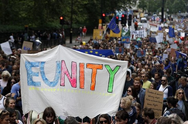 People hold banners during a 'March for Europe' demonstration against Britain's decision to leave the European Union, in central London, Britain July 2. Credit: Reuters/Tom Jacobs