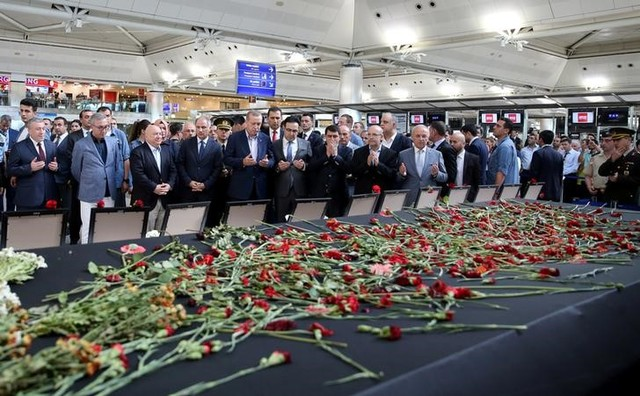 Turkish President Tayyip Erdogan prays for the airport employees who were killed in Tuesday's attack on the airport, during his visit to Ataturk airport in Istanbul, Turkey, July 2. Credit: Reuters Murat Cetinmuhurdar/P