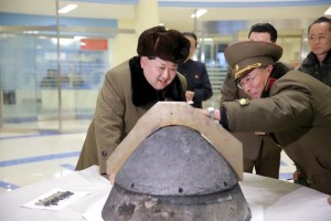 North Korean leader Kim Jong Un looks at a rocket warhead tip after a simulated test of atmospheric re-entry of a ballistic missile, at an unidentified location in this undated file photo released by North Korea's Korean Central News Agency (KCNA) in Pyongyang on March 15, 2016.  REUTERS/KCNA/File Photo
