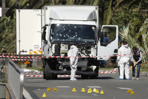 Investigators continue to work at the scene near the heavy truck that ran into a crowd at high speed killing scores who were celebrating the Bastille Day July 14 national holiday on the Promenade des Anglais in Nice, France, July 15. Credit: Reuters/Eric Gaillard