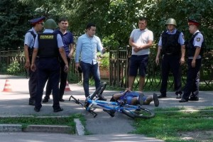 Police officers detain a man after an attack in the centre of Almaty, Kazakhstan, July 18, 2016. Credit: Reuters/Shamil Zhumatov