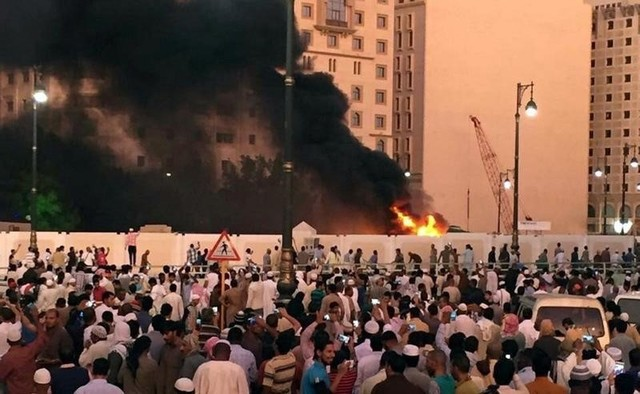 Muslim worshippers gather after a suicide bomber detonated a device near the security headquarters of the Prophet's Mosque in Medina, Saudi Arabia, July 4, 2016. Credit: Reuters/Handout