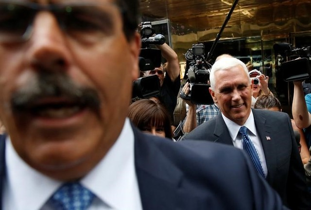 A Secret Service agent moves media away as Indiana Governor Mike Pence walks to his car after being named Donald Trump's Vice Presidential candidate in New York, U.S., July 15. Credit: Reuters/Carlo Allegri