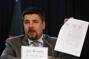 Rahmatullah Nabil, former head of Afghanistan's National Directorate Of Security (NDS), shows a paper during a joint news conference in Kabul September 7, 2011. REUTERS/Omar Sobhani/Files