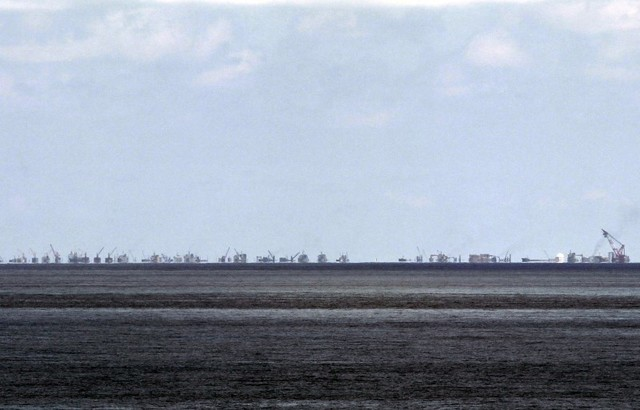 The alleged on-going land reclamation of China at Subi reef is seen from Pagasa island (Thitu Island) in the Spratlys group of islands in the South China Sea, west of Palawan, Philippines, May 11, 2015. Credit: Reuters/Ritchie B. Tongo/File Photo