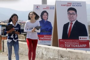 Women walk past posters of candidates from Mongolian People's Party (MAH) on the outskirts of Ulan Bator, Mongolia, June 27. Credit: Reuters/Jason Lee