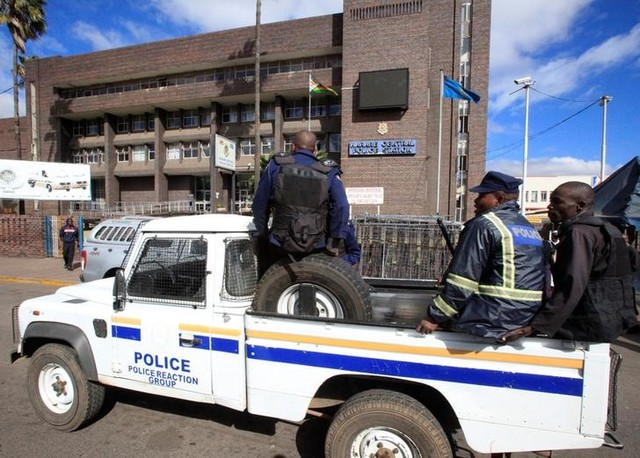 Anti-riot police drive past the Harare Central Police station, where Pastor Evan Mawarire (not in the picture), who organized a 'stay at home' anti-government protest, appeared in Zimbabwe July 12. Credit: Reuters/Philimon Bulawayo