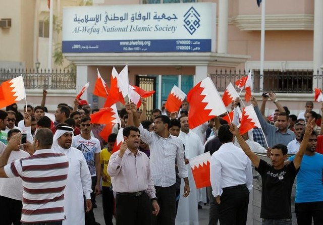 Anti-government protesters shout slogans while holding Bahraini flags during a protest outside Bahrain's leading opposition party Al Wefaq's headquarters in Manama in this file photo taken on May 9, 2012. Credit: Reuters/Hamad I Mohammed/Files