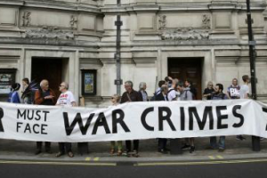 Demonstrators protest before the release of the John Chilcot report into the Iraq war, at the Queen Elizabeth II centre in London, Britain July 6, 2016. Credit: Reuters/Paul Hackett
