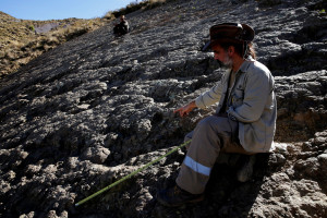 Paleontologist Sebastian Apesteguia points to a dinosaur's footprint in Chulku Mayu, in the syncline of Maragua, some 60 km of Sucre, Bolivia, July 21, 2016. Reuters/Files