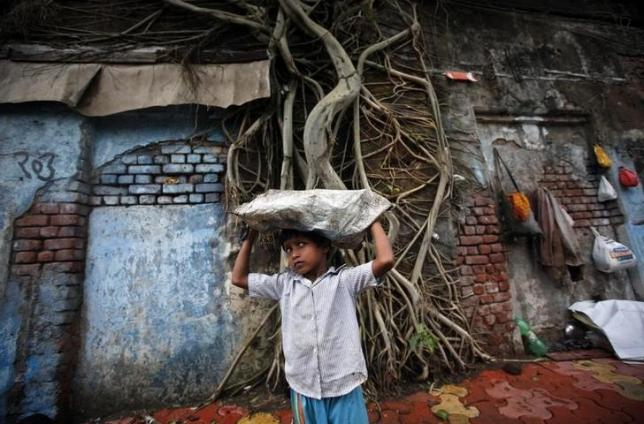 Five-year-old boy collects recyclables for resale at a residential area in Mumbai June 14, 2011. Credit: Reuters/Danish Siddiqui/Files