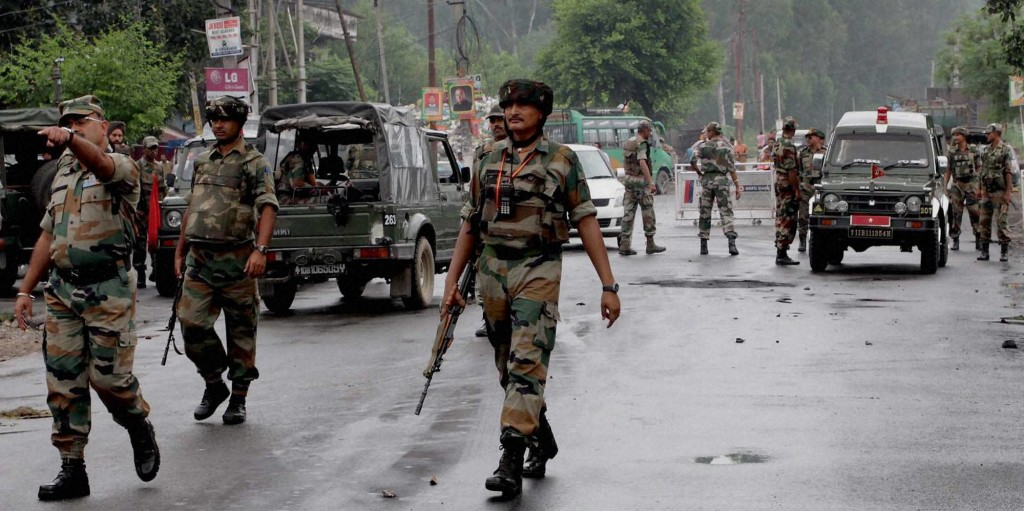 Jammu: Army personnel guard at a street during curfew in Jammu on Monday. The curfew has been clamped by the authorities in the view of violent protests over Kishtwar clash. Credit: PTI