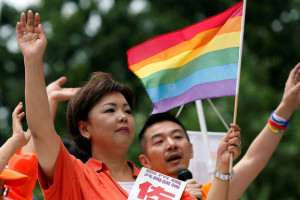 Kaori Sato, independent candidate running for the upcoming upper house election, holding a rainbow flag, waves as Hiroshi Taniyama (R), gay supporter of Sato from Nakano LGBT Network Nijiiro, speaks during a campaign for the July 10 upper house election in Tokyo, Japan, July 2, 2016.    Credit: Reuters/Toru Hanai