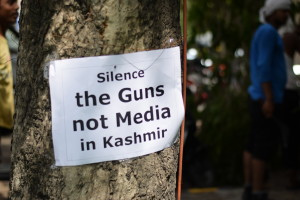 Protesters and the government face-off in Kashmir. Credits: PTI