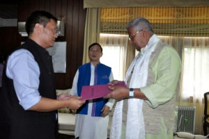 Pema Khandu, the new leader of the Congress Legislature Party in Arunachal Pradesh handing over letters of support from his MLAs to Governor Tathagata Roy.