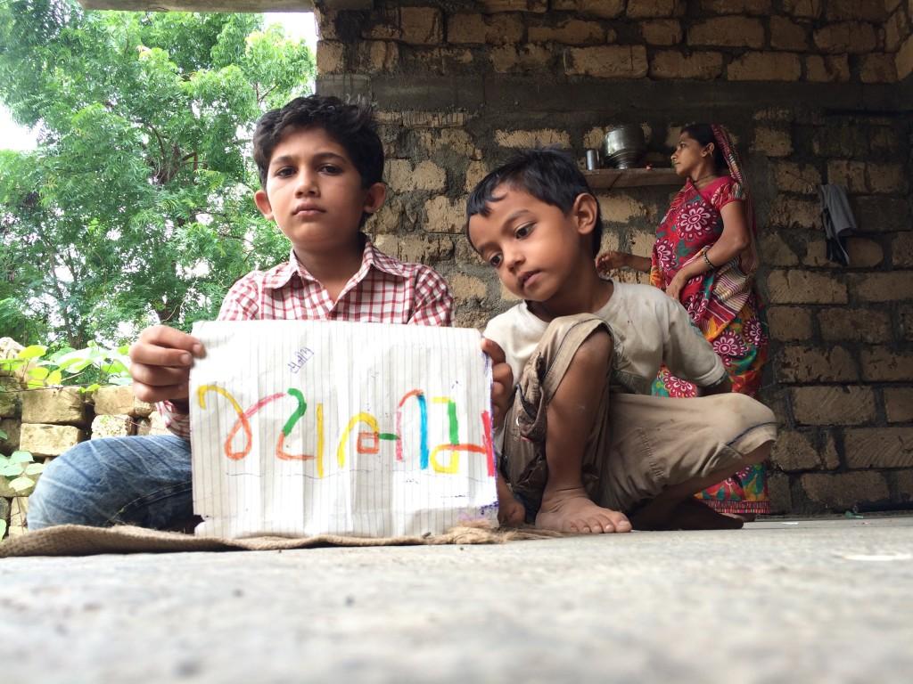 Manish holding up his notebook, where he has written 'Jai Bhim'. Source: Surabhi Vaya