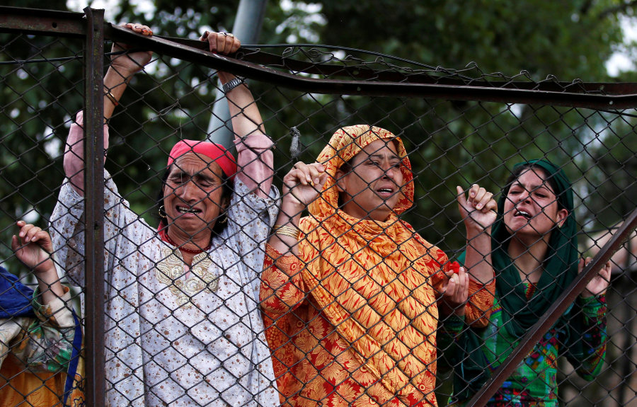 Kashmiri women mourn at Burhan Wani's funeral in Tral, south of Srinagar, July 9, 2016. Credit: Reuters/Danish Ismail
