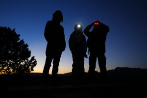 As darkness fall in the Arizona desert three boys await the arrival of UFO hunter Kim Carlsberg of UFO Sky Tours to begin their search outside Sedona, Arizona February 14, 2013. Credit: Reuters/Mike Blake