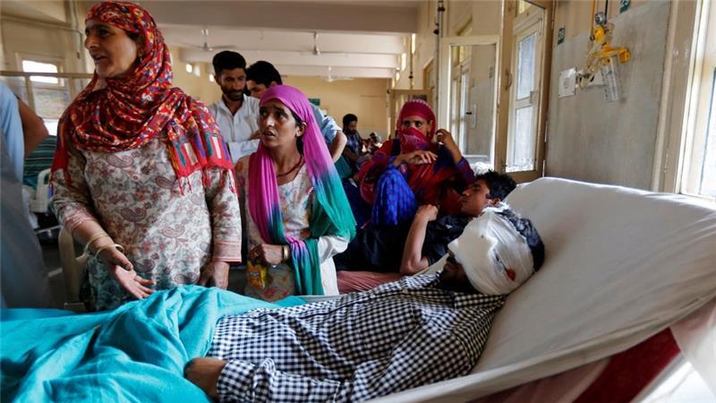 A man injured by a pellet gun lies in a Kashmir hospital. Credit: Reuters