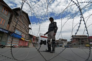 Security personnel guard a deserted street during the  curfew that has been imposed in different parts of the city following the killing of Hizbul Mujahideen commander Burhan Muzaffar Wani along with his two associates. Credit: PTI