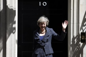 Britain's home secretary Theresa May, who is due to take over as prime minister on Wednesday, waves as she leaves after a cabinet meeting at number 10 Downing Street, in central London, Britain July 12, 2016. Credit: Reuters/Peter Nicholls