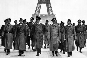 Adolf Hitler and his entourage take a stroll in Paris on June 23, 1940. Credit: German Federal Archives/Wikimedia Commons