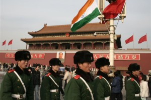 Chinese paramilitary policemen walk past an Indian flag in front of Tiananmen Gate in Beijing January 13, 2008. Credit: Reuters/Grace Liang/files