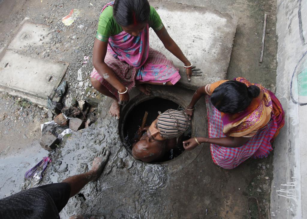 A labourer cleans an underground drain. Credit: Reuters/Rupak De Chowdhuri