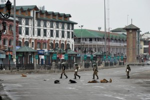Security jawans patrolling the Lal Chowk area during curfew in Srinagar on Friday.  Credit: PTI/ S. Irfan