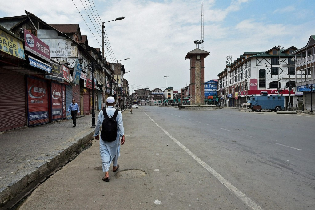 Deserted view of Lal Chowk during restrictions and strike on the fourth consecutive day in Srinagar on Tuesday. Authorities imposed restrictions in most parts of Valley following the killing of Hizbul Mujahideen commander, Burhan Muzaffar Wani, along with his two associates. Credit: PTI Photo by S Irfan