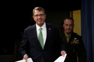 U.S. Secretary of Defense Ash Carter (front) and Chairman of the Joint Chiefs of Staff General Joseph F. Dunford arrive at a joint news conference at the Pentagon in Washington, U.S. July 25, 2016. Credit: REUTERS/Yuri Gripas
