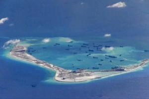 Chinese dredging vessels are purportedly seen in the waters around Mischief Reef in the disputed Spratly Islands in the South China Sea in this still image from video taken by a P-8A Poseidon surveillance aircraft provided by the United States Navy May 21, 2015. Credit: US Navy/Handout via Reuters/File Photo