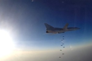 A still image, taken from video footage and released by Russia's Defence Ministry on August 16, 2016, shows a Russian Tupolev Tu-22M3 long-range bomber based in Iran dropping off bombs at an unknown location in Syria. Ministry of Defence of the Russian Federation/Handout via Reuters