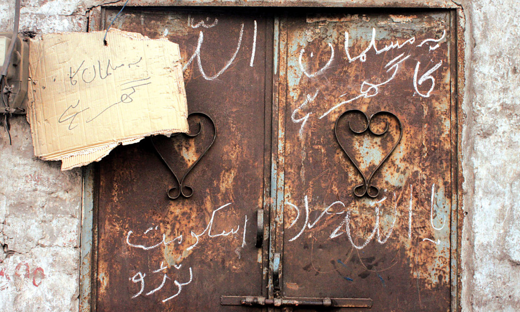 The owner of a house publicises his identity to avert assault by an angry mob in Joseph Colony in Lahore. Credit: Azhar Jafri/White Star/Herald