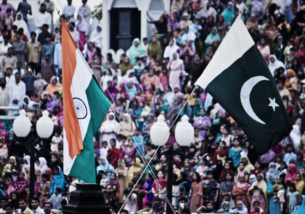 India and Pakistan flags being lowered at the Wagah border. Credit: Jack Zalium/Flickr CC BY-NC 2.0