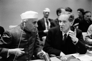 During his visit yesterday at U.N. Headquarters, the Prime Minister of India, Jawarhalal Nehru, met with representatives of the Commonwealth group of nations in Conference Room 8. Mr. Nehru listens to Sir Pierson Dixon, the United Kingdom's Permanent Representative to the U.N. on December 21, 1956. Credit: UN Photo