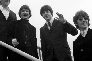 Waves from the smiling Beatles as they board an airliner at London Airport./PA Archive, The Converstion