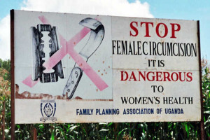 Campaign road sign in Uganda against FGM. Credit: Wikimedia Commons